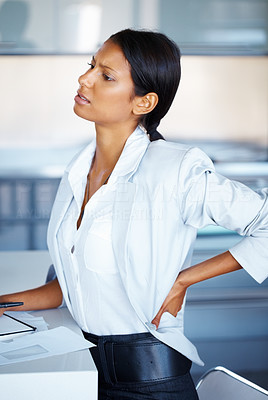 Buy stock photo Business woman taking break to stretch back