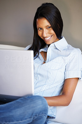 Buy stock photo View of casually dressed woman sitting with laptop