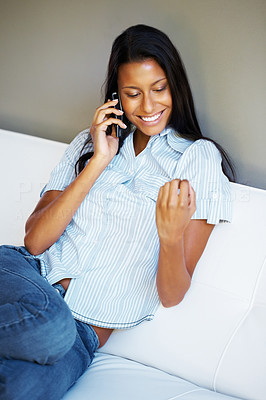 Buy stock photo Pretty woman on phone and looking at fingernails