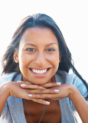 Buy stock photo Pretty woman outdoors resting her chin on her clasped hands