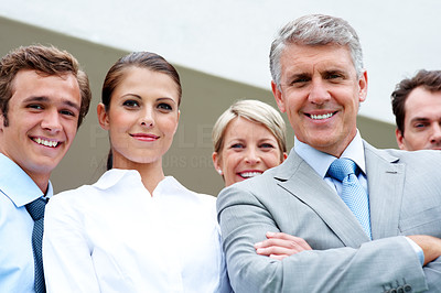 Buy stock photo Successful business team - Happy senior male executive smiling with his coworkers