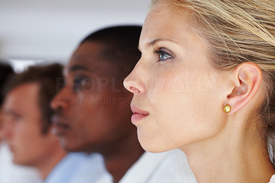 Buy stock photo Profile image of a confident young woman at a conference with her colleagues in background