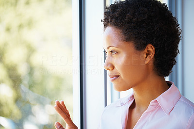 Buy stock photo Thought African American business woman looking through glass window