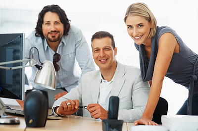 Buy stock photo Business team smiling together at work place