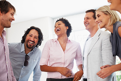 Buy stock photo Happy business people enjoying discussion in the office