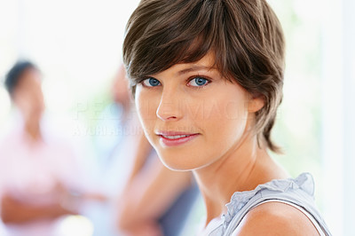 Buy stock photo Side view of attractive woman with group of people in background