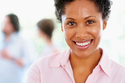 Buy stock photo Closeup of attractive woman with group in background