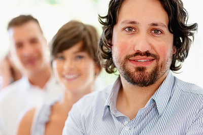 Buy stock photo Focus on man with team in row in background