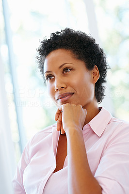 Buy stock photo Low angle view of woman resting chin on hand