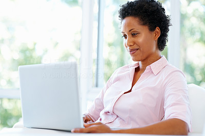 Buy stock photo View of pretty woman working on laptop indoors