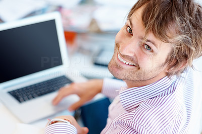 Buy stock photo Rear view of handsome man at laptop