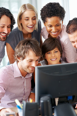 Buy stock photo Young professionals working together on computer