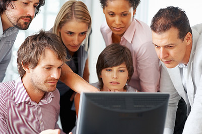 Buy stock photo Woman pointing at computer and explaining plan of work to colleagues