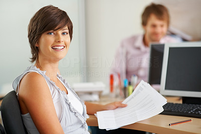 Buy stock photo Happy young business woman with paper work at office