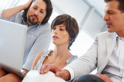 Buy stock photo Pretty young business woman with team working on laptop