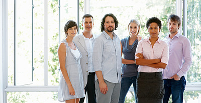 Buy stock photo Young and attractive business people standing together at office
