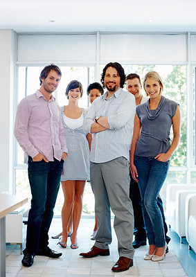 Buy stock photo Full length of successful business man with his supporting team at office