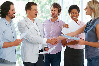 Buy stock photo Business man with his team shaking hands with partner in the office