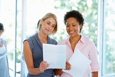 Buy stock photo Two business women holding documents at office