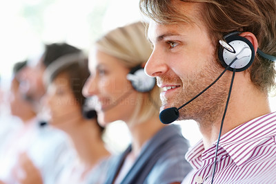 Buy stock photo Closeup of smiling call center executive working in office