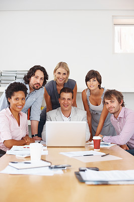 Buy stock photo Leader with his team smiling in a conference room