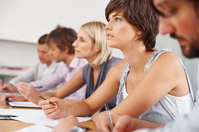 Buy stock photo Business woman sitting with colleagues at meeting in office