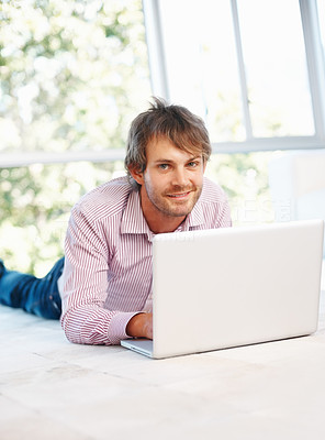 Buy stock photo Young handsome man using laptop from home