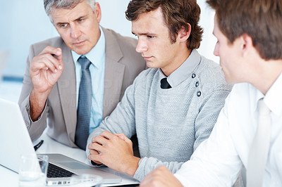 Buy stock photo Team of business executives working together on a laptop at office