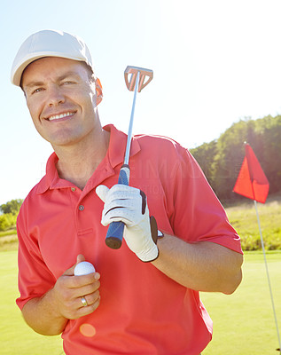Handsome golfer with his putter