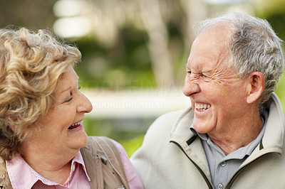 Buy stock photo Closeup of a cheerful mature couple looking at each other