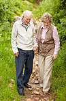 Happy mature couple walking together in countryside