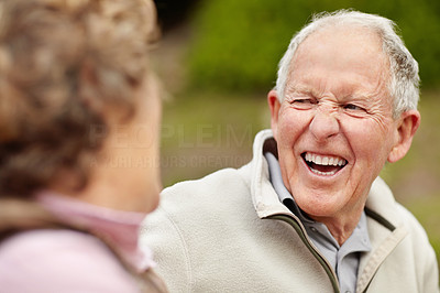 Buy stock photo Portrait of a cheerful mature man laughing while looking at senior woman