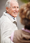 Happy mature man with a senior woman looking at you