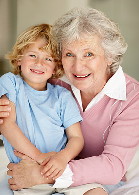 Buy stock photo Portrait of a happy little boy sitting on his grandmothers lap