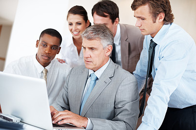 Buy stock photo Group of business people working together on laptop at office - Teamwork