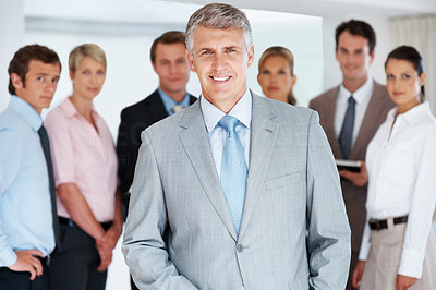 Buy stock photo Portrait of a happy successful mature businessman leading his team at office