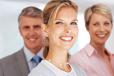 Buy stock photo Portrait of a smiling young businesswoman and her colleagues in background