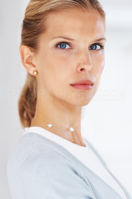 Buy stock photo Portrait of a confident young female business executive with serious look