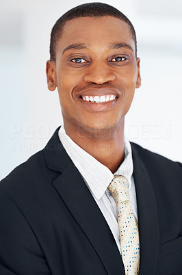 Buy stock photo Closeup portrait of an african american businessman smiling at office