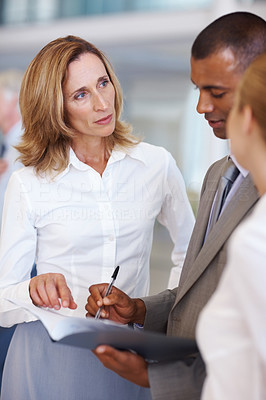 Diverse business people discussing about documents