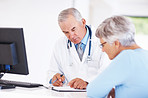 Doctor discussing medical report with patient