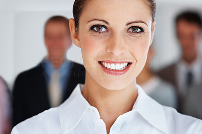 Buy stock photo Closeup portrait of cute business woman with group of colleagues at the back
