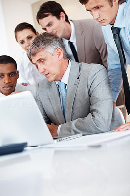 Buy stock photo Group of businesspeople together working on laptop in a board room at office
