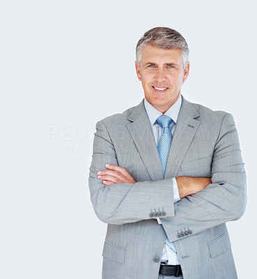 Buy stock photo Portrait of a successful mature businessman in suit standing with folded hands at office