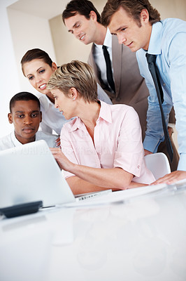 Buy stock photo Group of a businesspeople discussing together on laptop - team work