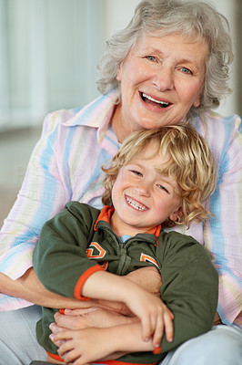 Buy stock photo Portrait of a young boy and his granny enjoying a laugh together