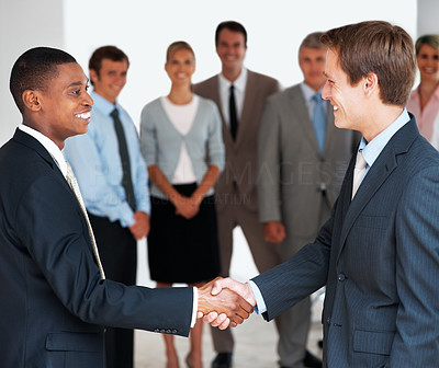 Buy stock photo Portrait of successful business people shaking hands with each other after a deal