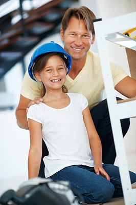 Buy stock photo Portrait of father and daughter building shelf and smiling