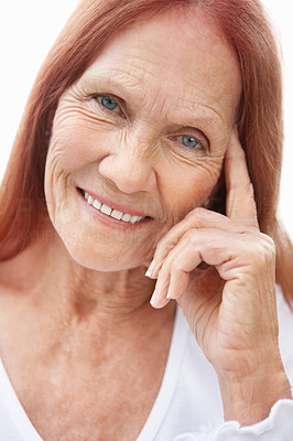 Buy stock photo Closeup portrait of a happy mature woman giving a cute smile