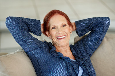Buy stock photo Closeup portrait of a happy senior redhead relaxing in sofa with hands behind head